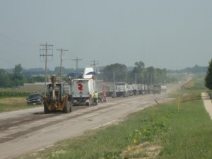Trucks lined up in front of milling equipment.  7-2-12