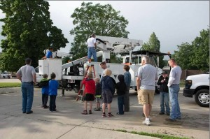 Particpants wait in line for bucket truck lifts